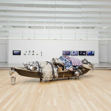 Subodh Gupta, What does the room encompass that is not in the city?. 2014, found boat, found objects, found utensils, fabric, steel, found fishing net, bamboo, rope, plastic pipe. 573 x 152.4 x 122 cm. Photo by Hai Zhang