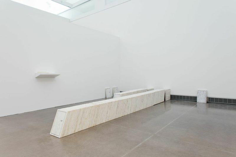 Shilpa Gupta.1278 unmarked, 28 hours by foot via National Highway No 1, east of the Line of Control. 2013. Interactive Installation. 1278 Etched marble slabs. 11.79 x 18.08 x 0.59 inches (30.00 x 46.00 x 1.50 centimeters) Courtesy of the Artist, Chemould Prescott Road and Vadehra Art Gallery. Photo by Hai Zhang