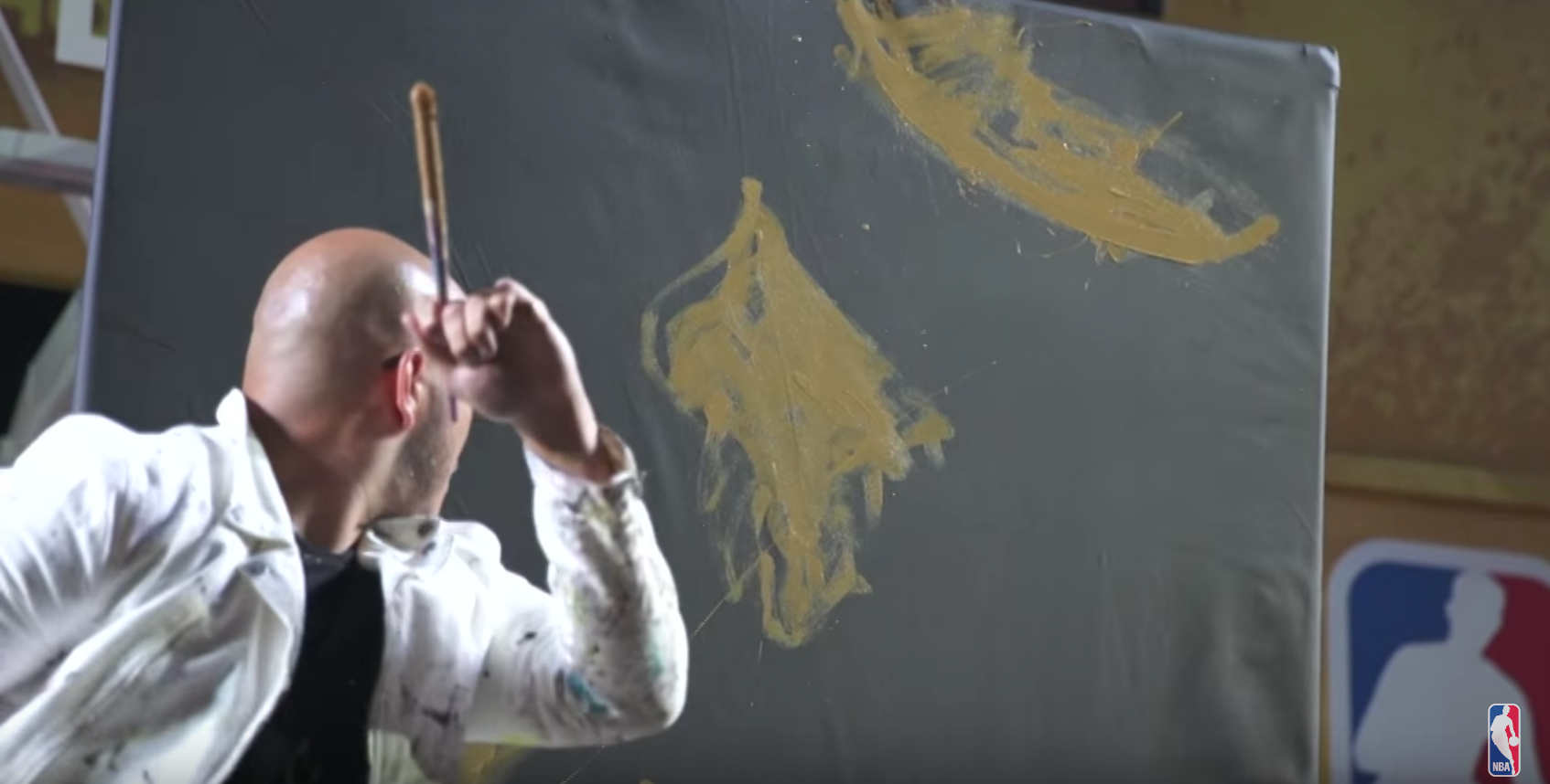 LeBron James gets painted upside down at NBA House Rio by artist David Garibaldi